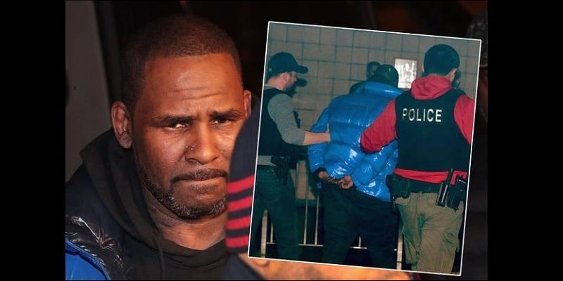 Photo de R. Kelly arrêté et inculpé de 10 chefs d'accusation. Voici la peine de prison qu'il risque!