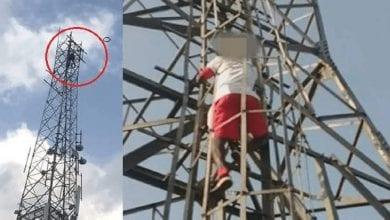 Photo de Nigeria: il escalade un mât électrique pour exiger la démission du président Buhari