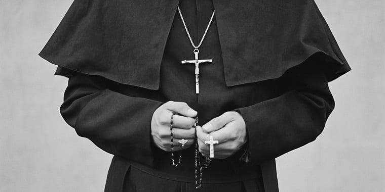 priest with crucifix